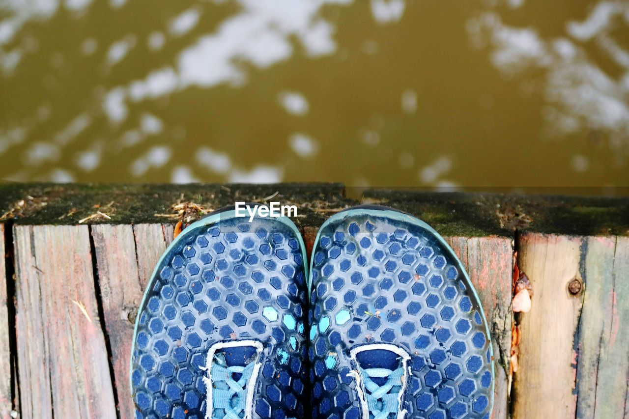 High Angle View Of Blue Shoe On Jetty