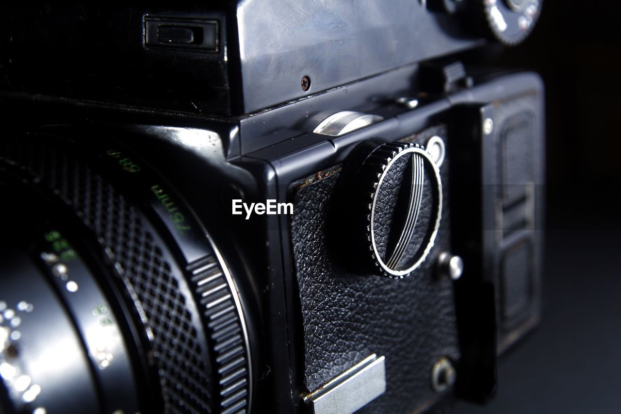 technology, close-up, photography themes, no people, camera - photographic equipment, selective focus, equipment, retro styled, indoors, number, still life, black color, communication, focus on foreground, photographic equipment, text, camera, western script, analog, electrical equipment, digital camera