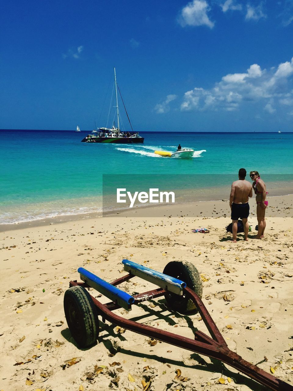 sea, beach, sand, horizon over water, water, shore, sky, day, nature, cloud - sky, rear view, real people, transportation, outdoors, beauty in nature, scenics, men, vacations, full length, nautical vessel, people