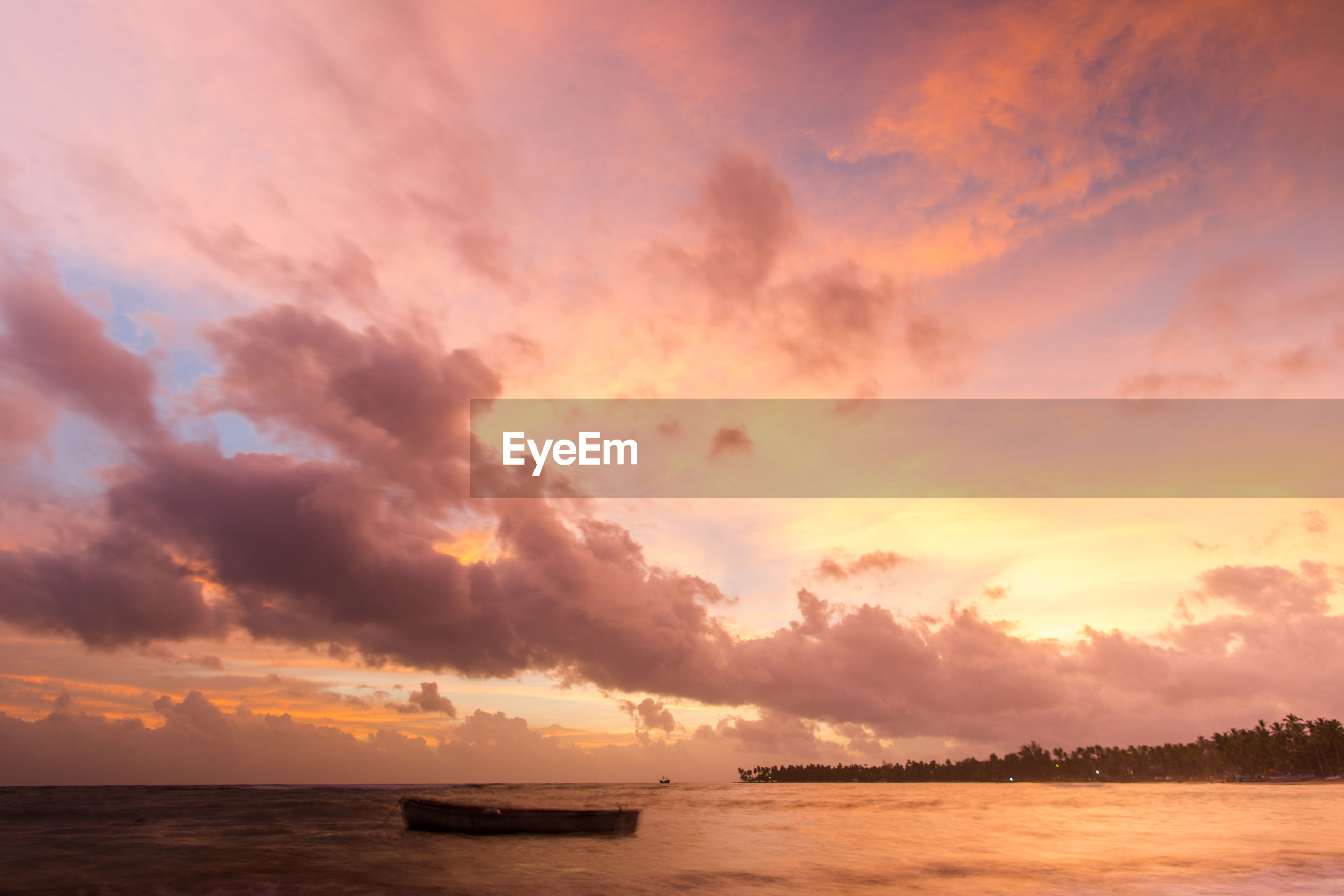 sunset, water, sea, scenics, tranquil scene, tranquility, waterfront, nautical vessel, calm, beauty in nature, ocean, sky, cloud, boat, transportation, idyllic, nature, orange color, majestic, dramatic sky, cloud - sky, moody sky, atmospheric mood, sun, cloudscape, no people, outline, remote, multi colored, cloudy