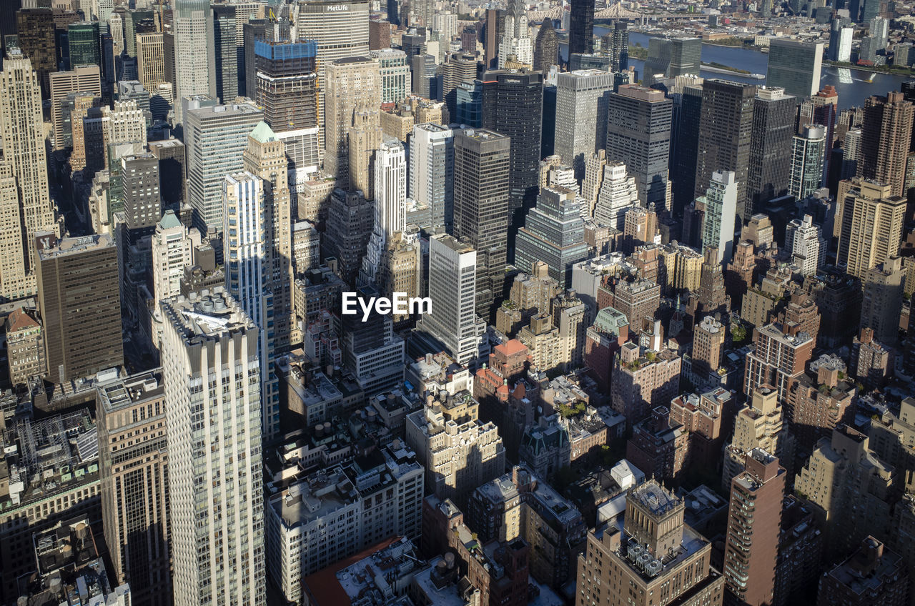 city, cityscape, building exterior, architecture, built structure, skyscraper, office building exterior, high angle view, building, tower, travel destinations, crowd, day, modern, downtown district, crowded, aerial view, tall - high, city life, outdoors, financial district