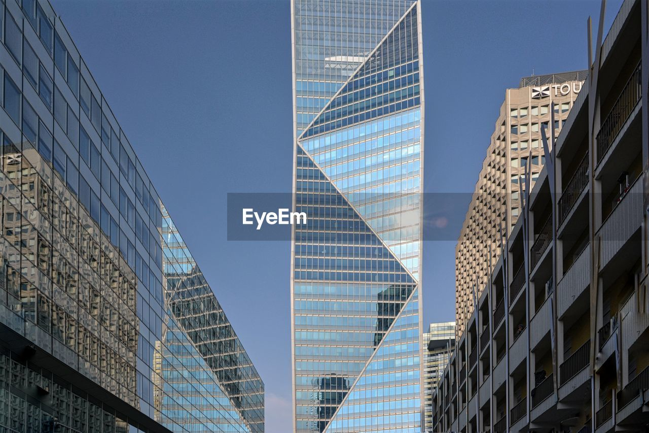 building exterior, architecture, built structure, building, office building exterior, city, modern, office, low angle view, skyscraper, glass - material, tall - high, no people, sky, day, tower, clear sky, nature, reflection, outdoors, financial district