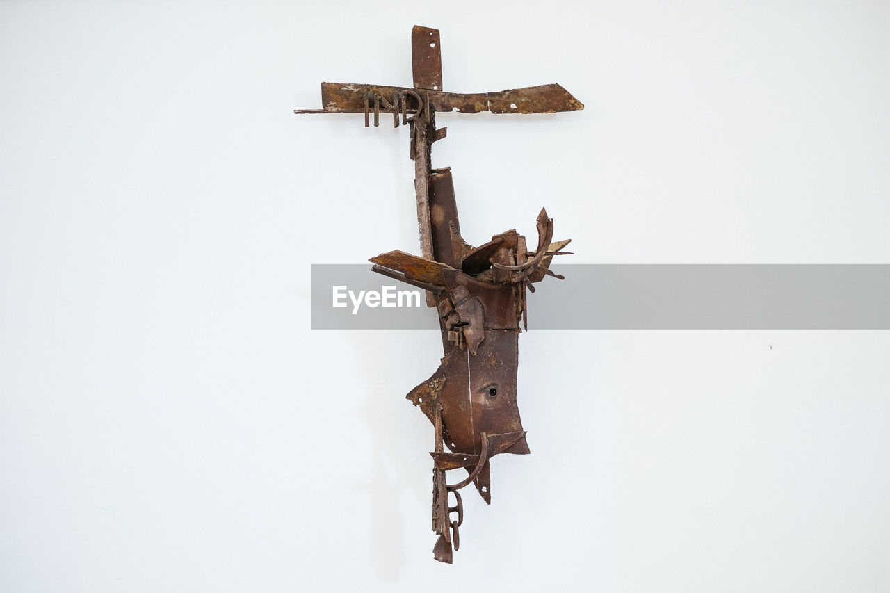 High angle view of rusty metal on white background