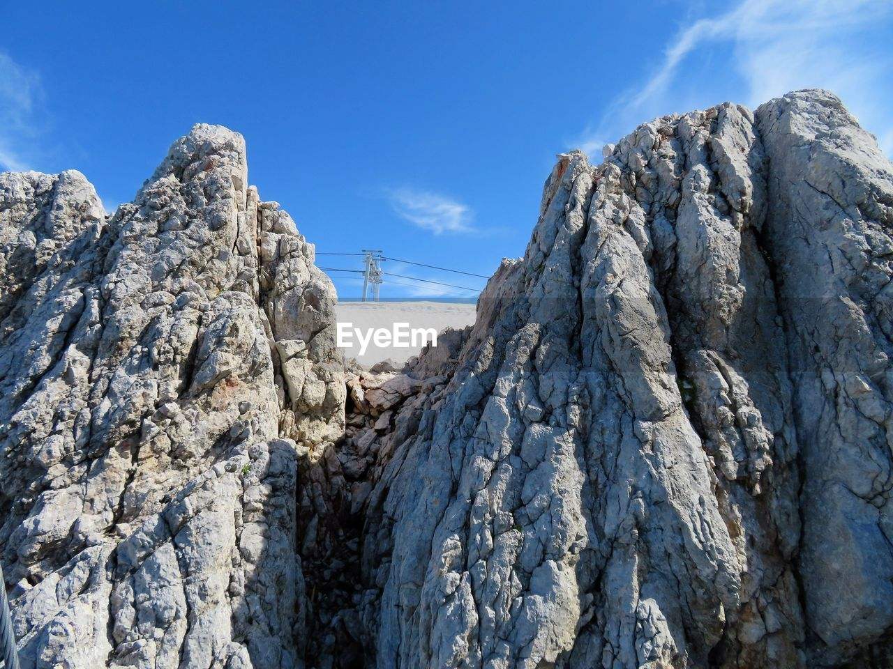 rock - object, sky, nature, day, outdoors, low angle view, beauty in nature, no people, mountain, blue, cold temperature, snow, tree, glacial