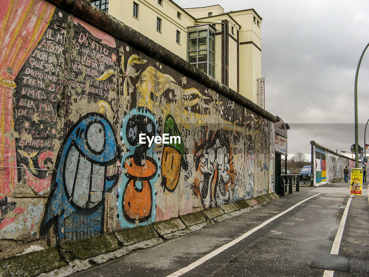 graffiti, art and craft, architecture, built structure, street art, day, outdoors, building exterior, no people, sky