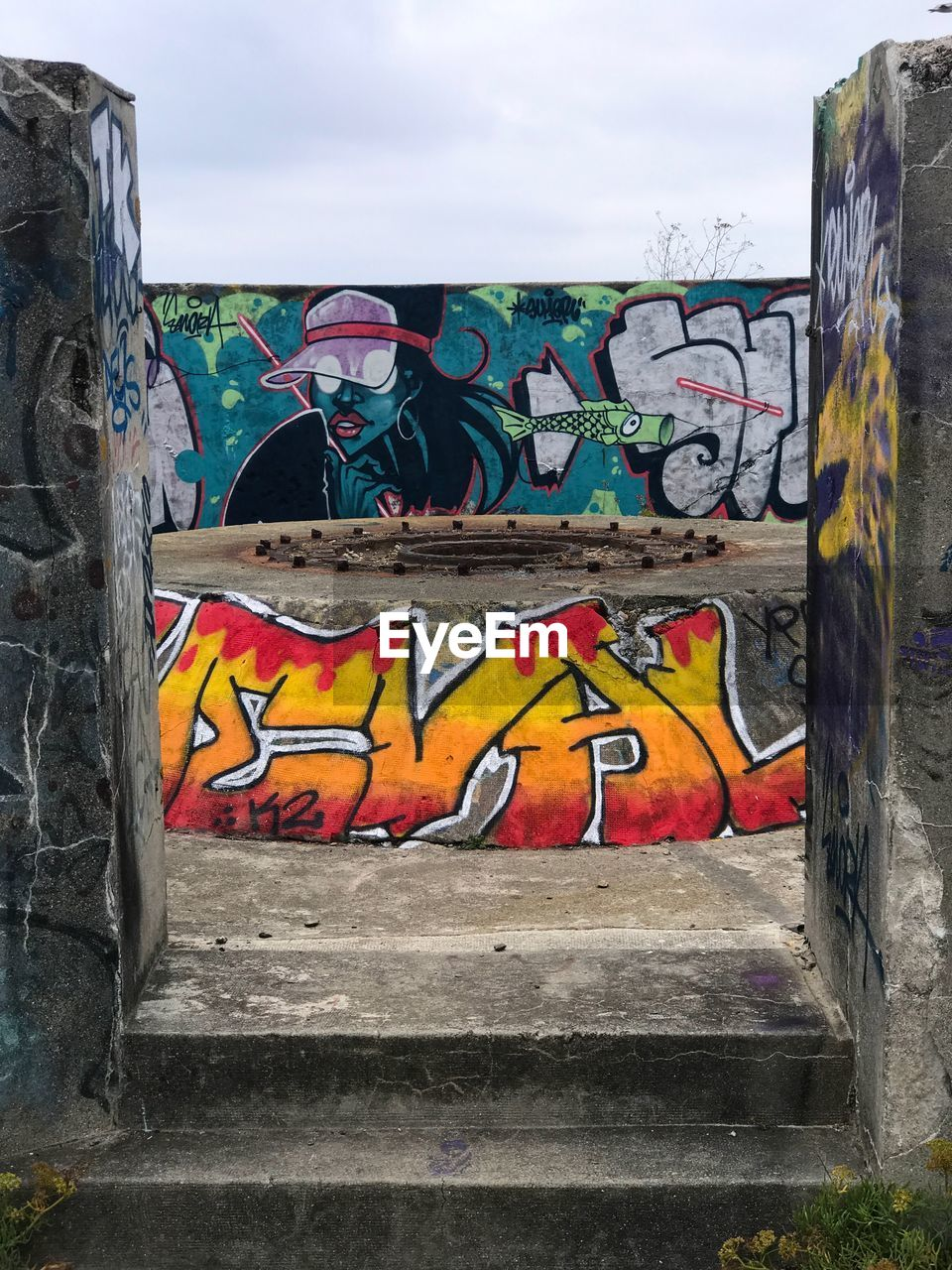 creativity, graffiti, art and craft, multi colored, representation, street art, human representation, wall - building feature, architecture, built structure, day, no people, mural, sky, wall, text, male likeness, outdoors, nature, building exterior