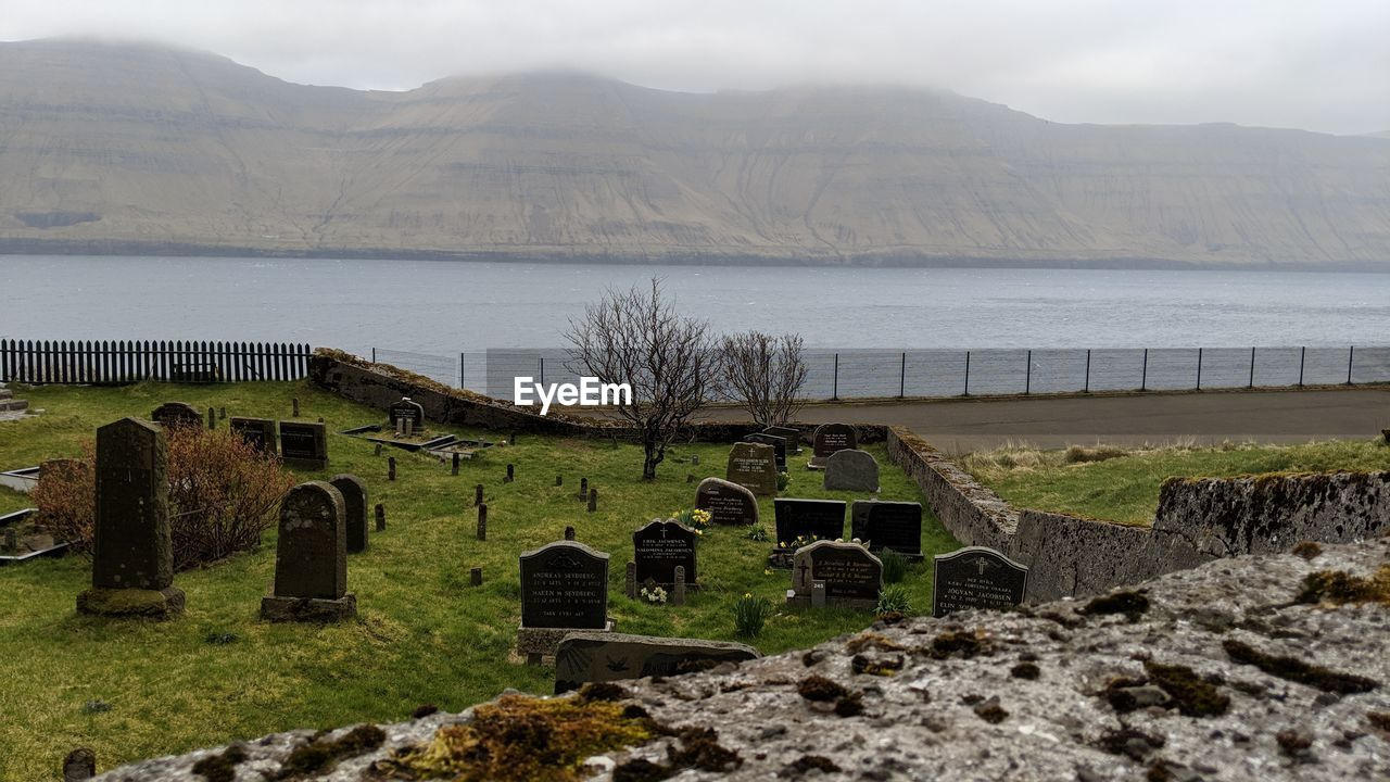 mountain, grave, tombstone, cemetery, sky, nature, day, stone, history, no people, the past, architecture, mountain range, cross, religion, tranquility, plant, outdoors