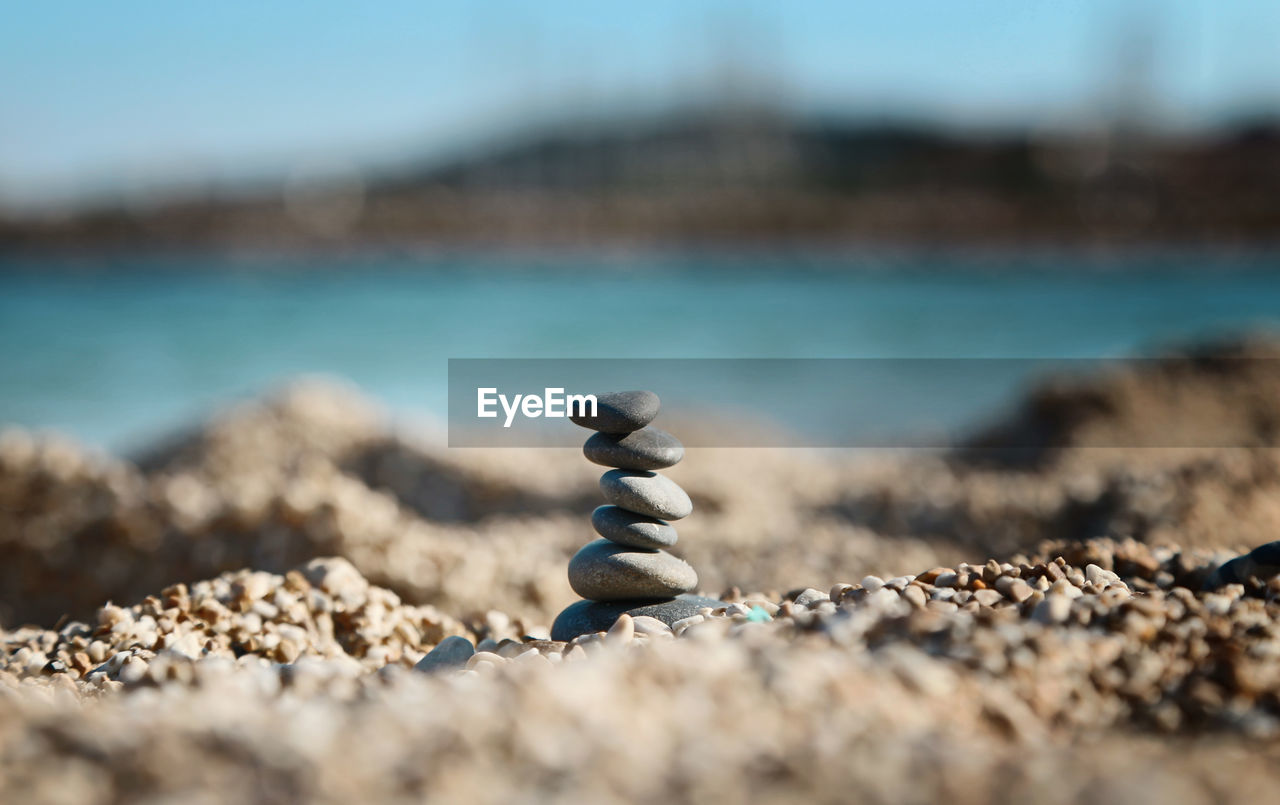Close-up of stacked pebbles at beach