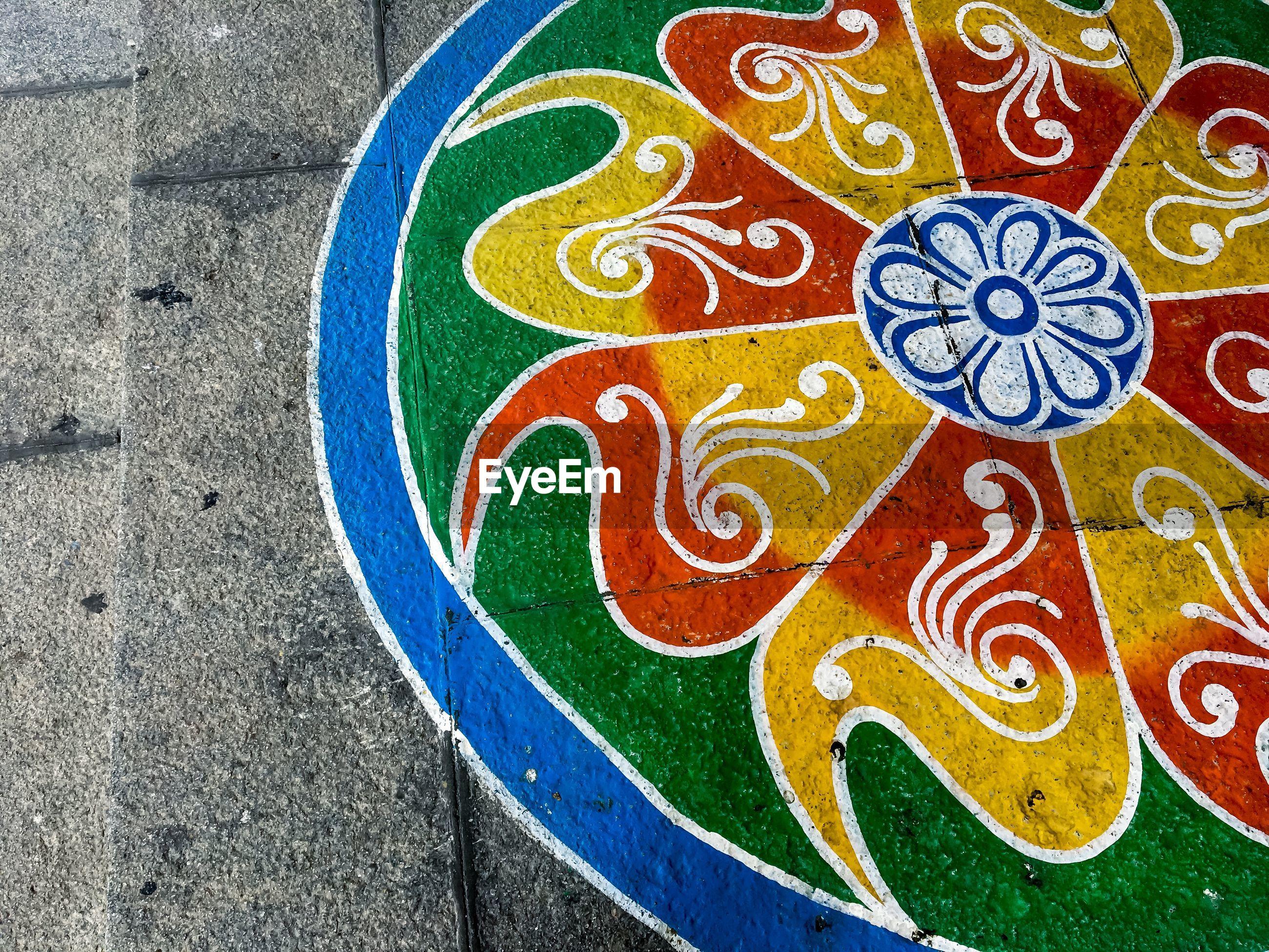 High angle view of rangoli painted on street