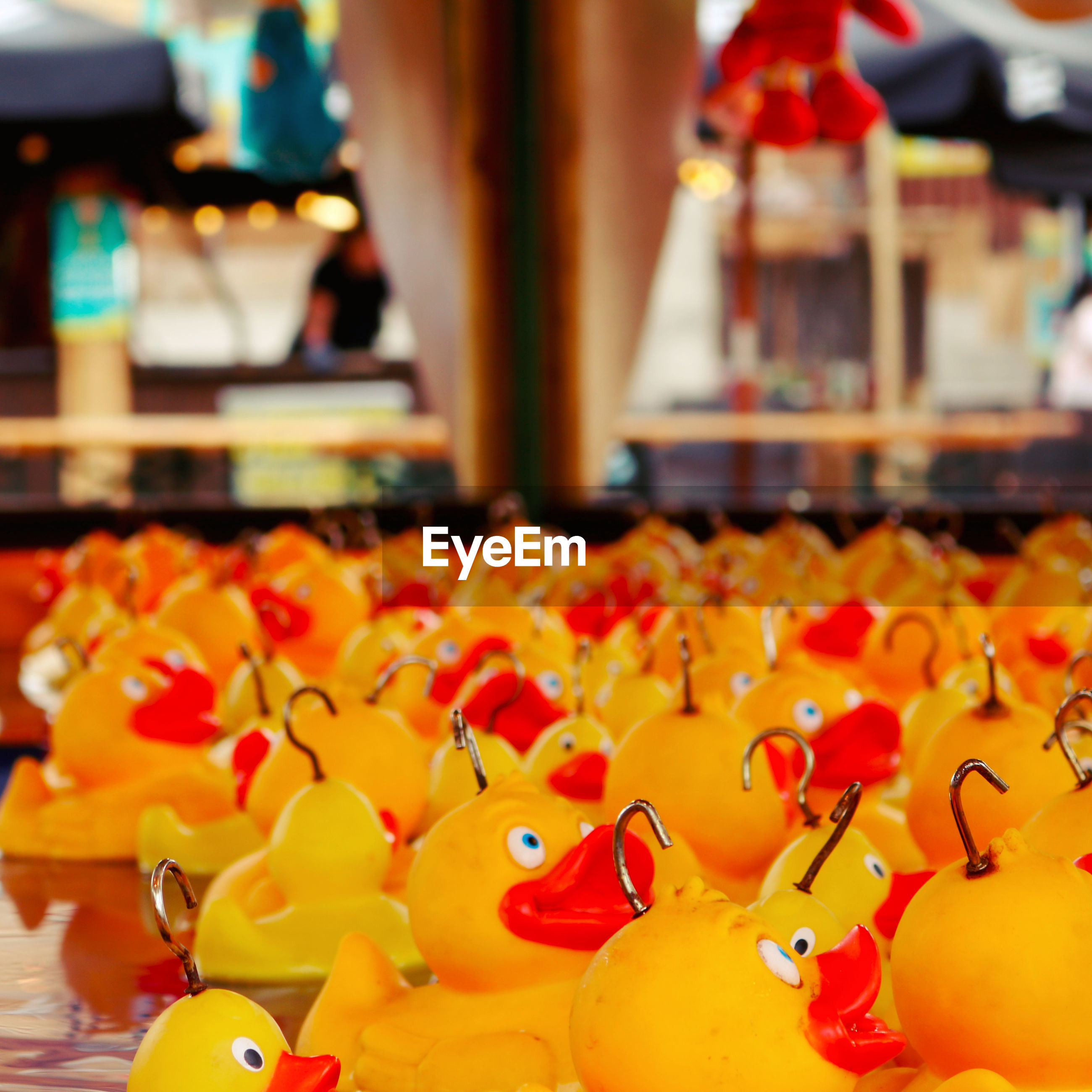 Toy ducks with hooks at amusement park
