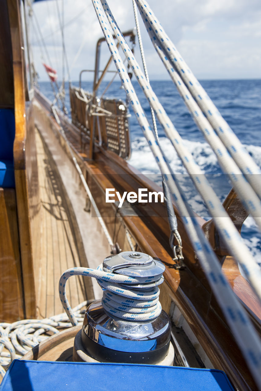 nautical vessel, water, transportation, mode of transportation, rope, sea, no people, day, ship, tied up, nature, focus on foreground, deck, sailboat, sky, metal, travel, outdoors, sailing, yacht, luxury, steel