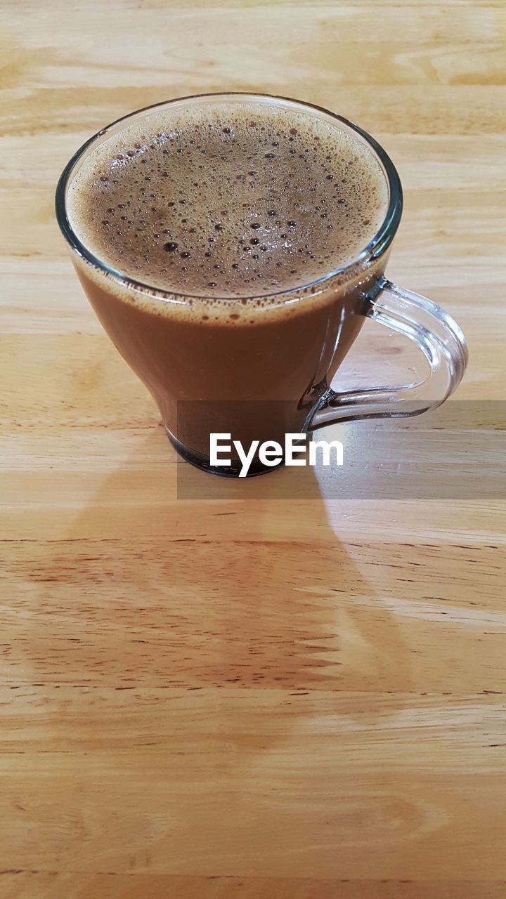 drink, coffee cup, coffee - drink, food and drink, refreshment, table, frothy drink, indoors, freshness, froth, close-up, no people, wood - material, high angle view, cappuccino, latte, froth art, mocha, day