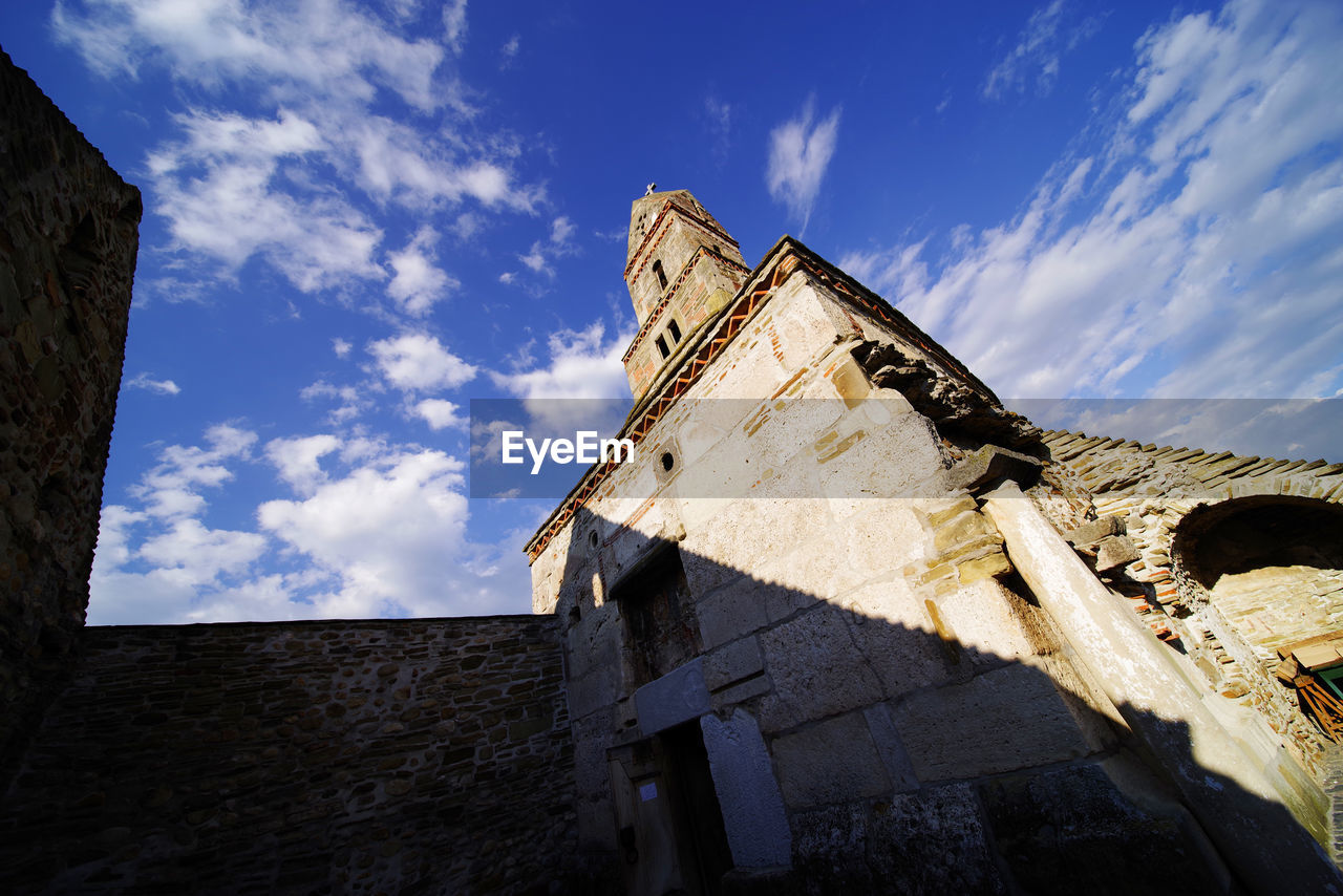 Low angle view of old church against sky