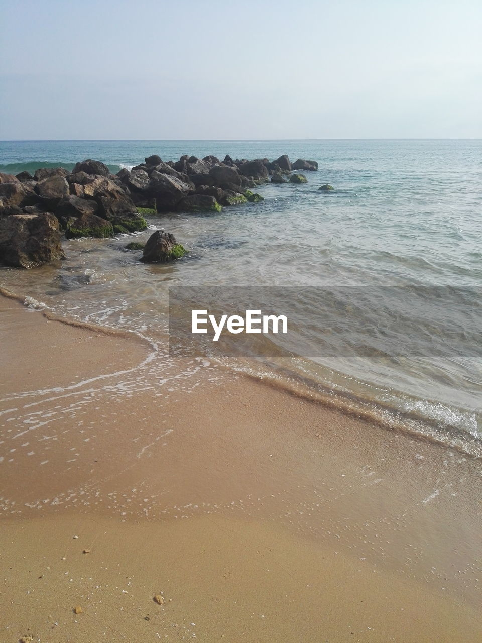 sea, water, beach, land, horizon, sky, horizon over water, beauty in nature, scenics - nature, sand, nature, tranquil scene, tranquility, clear sky, rock, no people, motion, idyllic, non-urban scene, outdoors