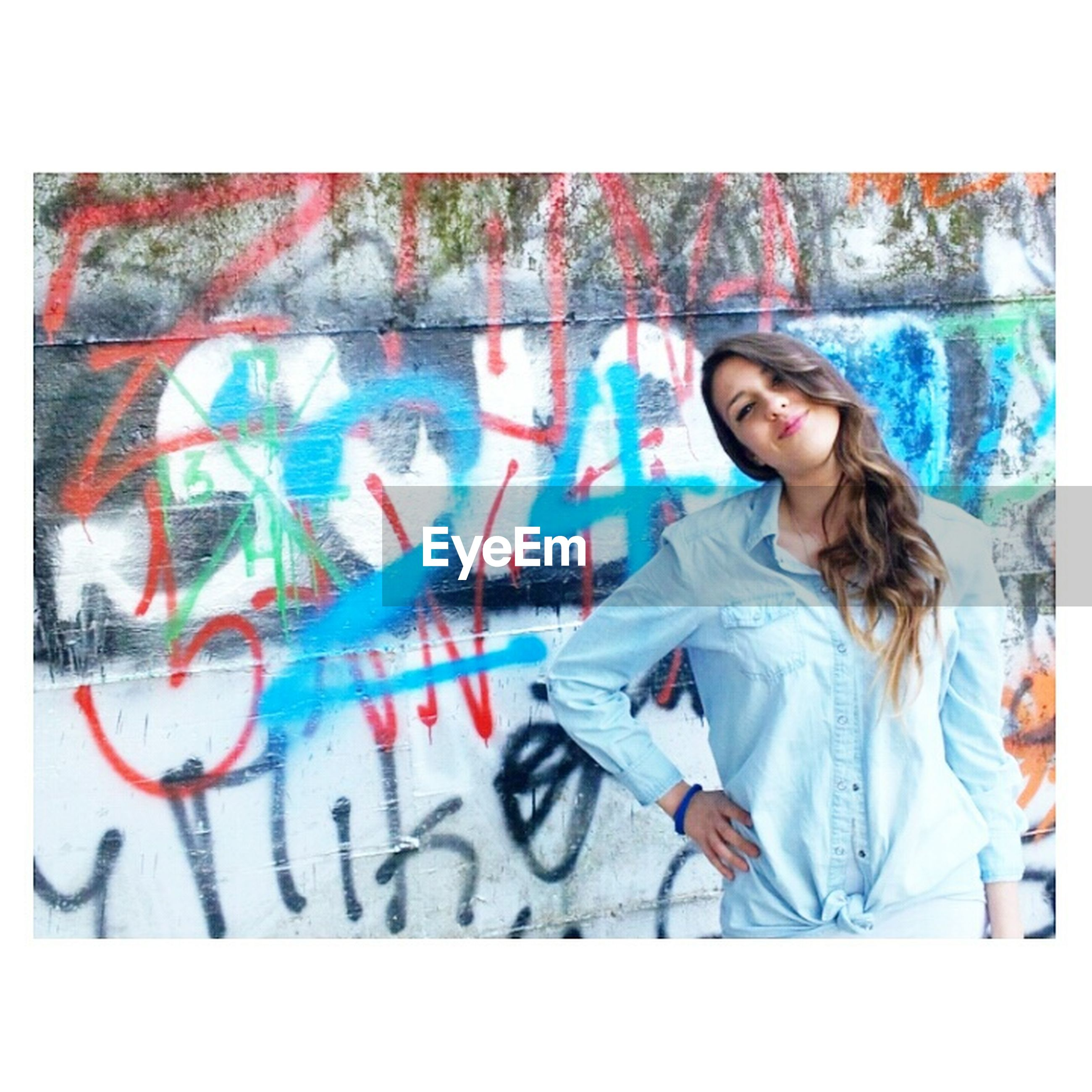 transfer print, auto post production filter, graffiti, art, creativity, art and craft, lifestyles, leisure activity, text, wall - building feature, young adult, western script, casual clothing, communication, person, indoors, multi colored, front view