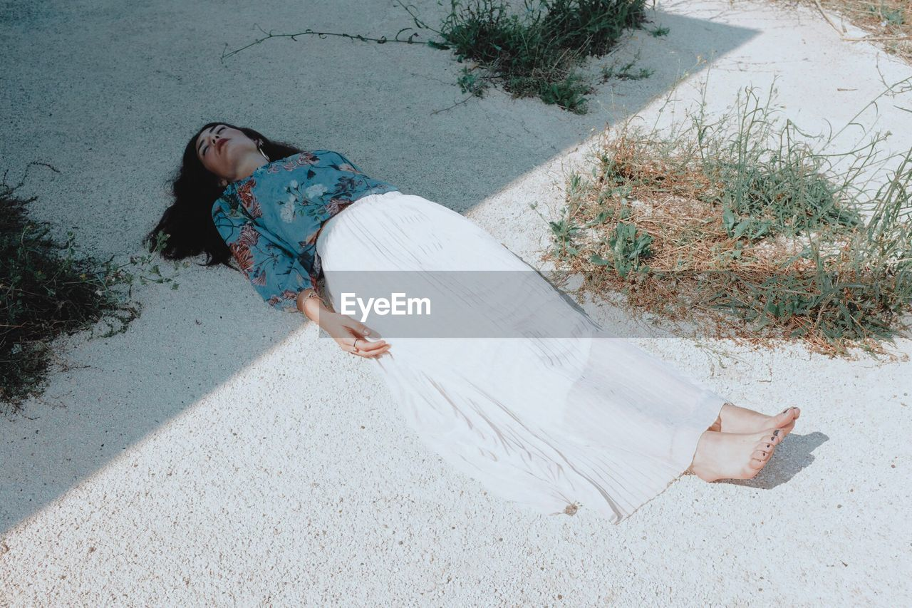 Woman Sleeping On Footpath In Sunny Day