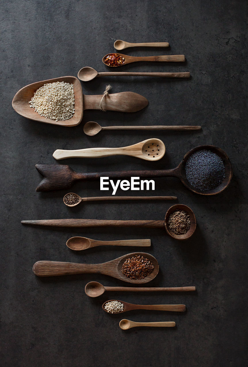 indoors, directly above, variation, choice, spoon, spice, still life, large group of objects, wood - material, food and drink, no people, food, kitchen utensil, table, high angle view, eating utensil, cinnamon, studio shot, freshness, ingredient, wooden spoon, order, tray