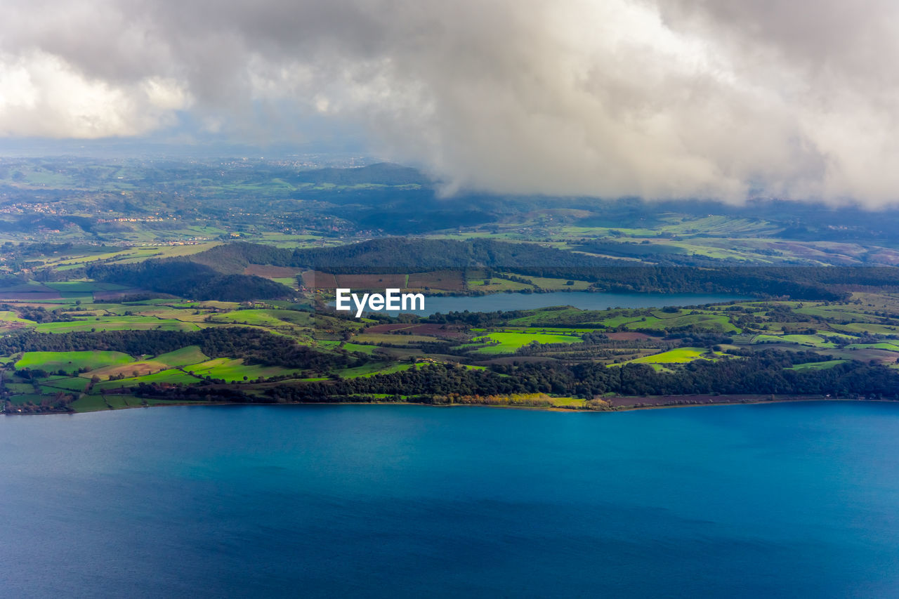 scenics - nature, cloud - sky, beauty in nature, tranquil scene, sky, water, tranquility, nature, day, idyllic, environment, no people, landscape, sea, non-urban scene, waterfront, mountain, land, outdoors, view into land, turquoise colored