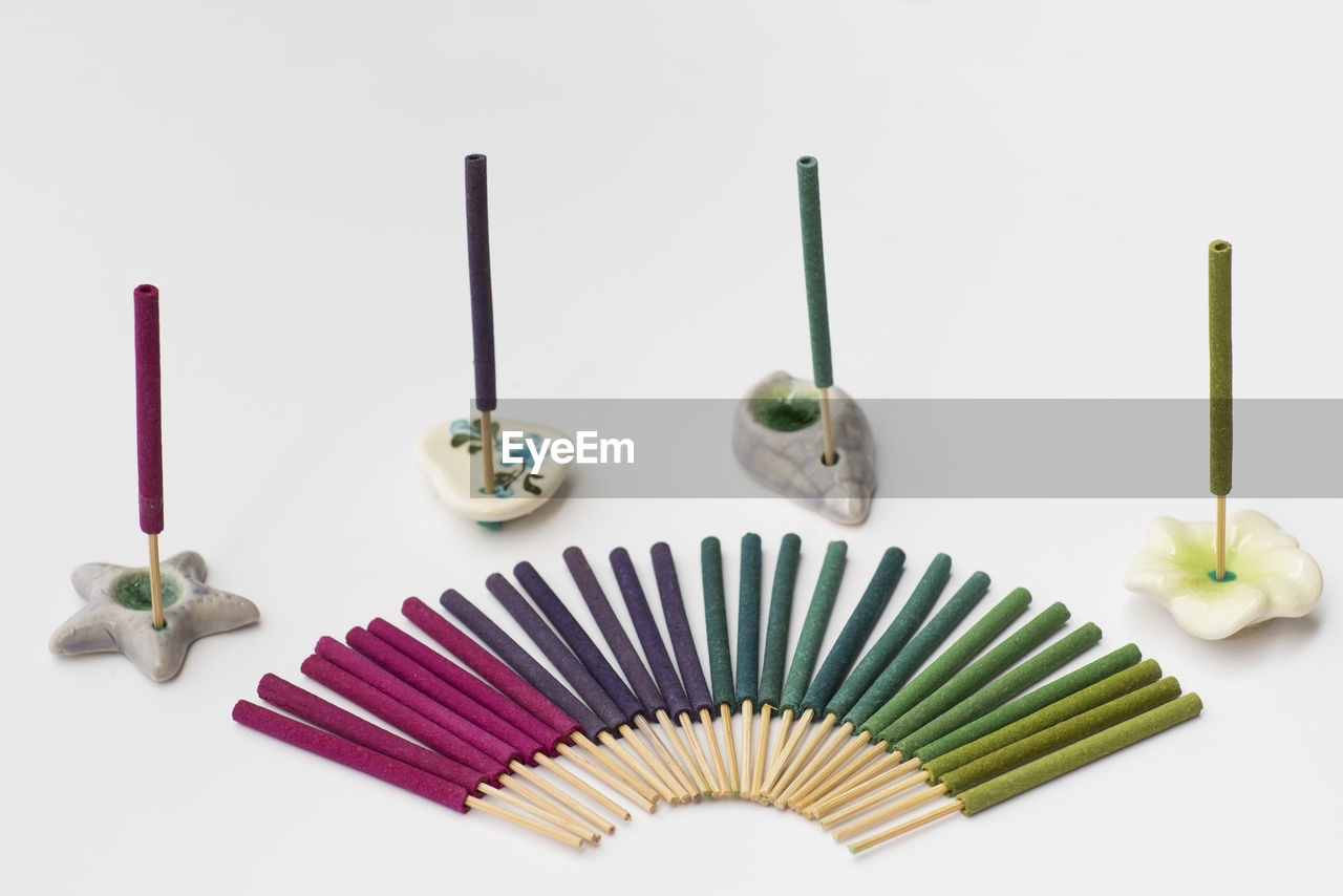 still life, indoors, art and craft, studio shot, white background, no people, creativity, close-up, large group of objects, choice, pencil, multi colored, variation, craft, collection, high angle view, colored pencil, directly above, group of objects, art and craft equipment