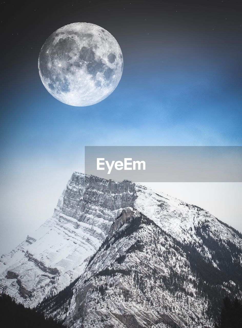 VIEW OF MOON AGAINST SKY