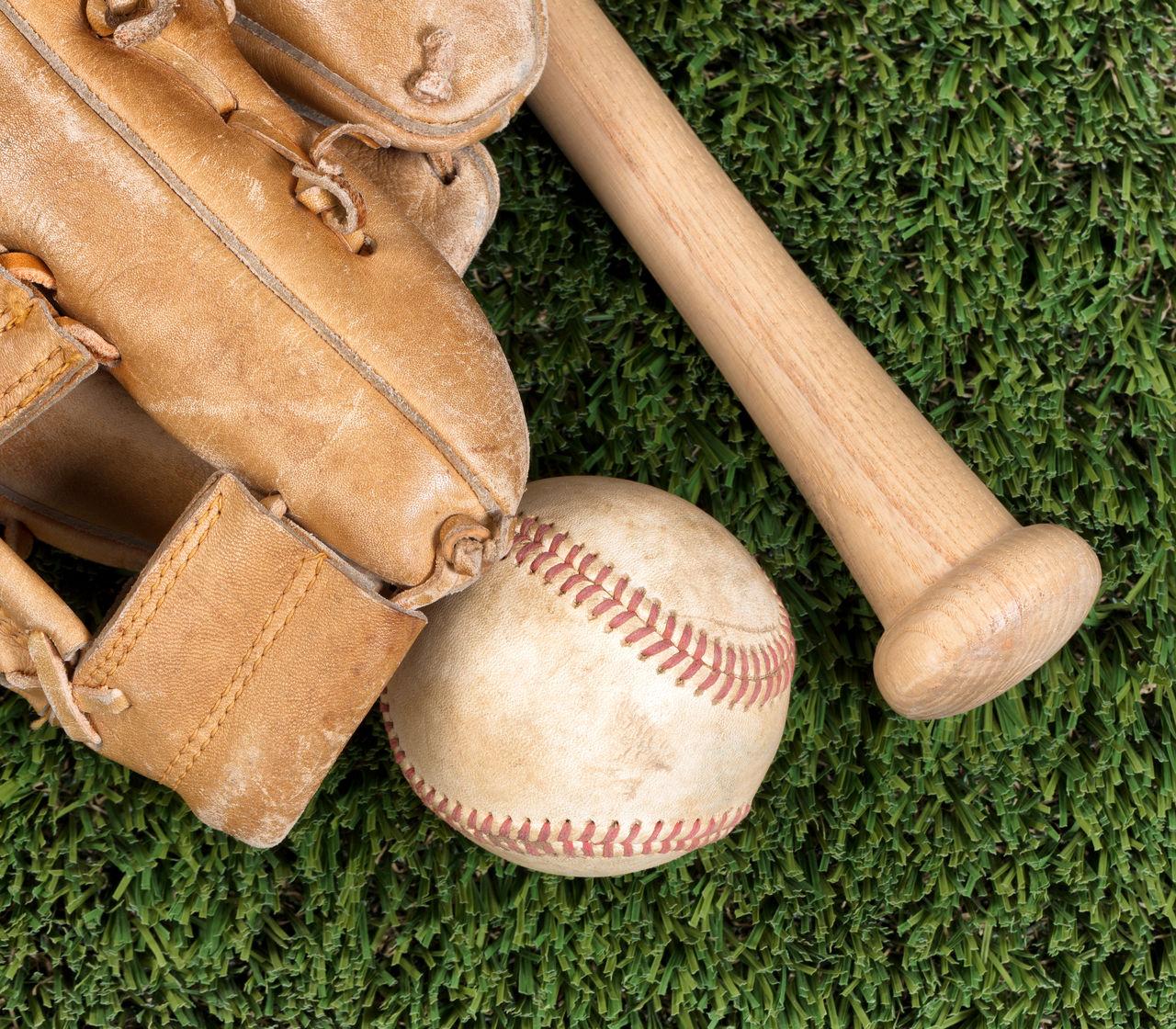 Close-Up Of Baseball Equipment On Grass