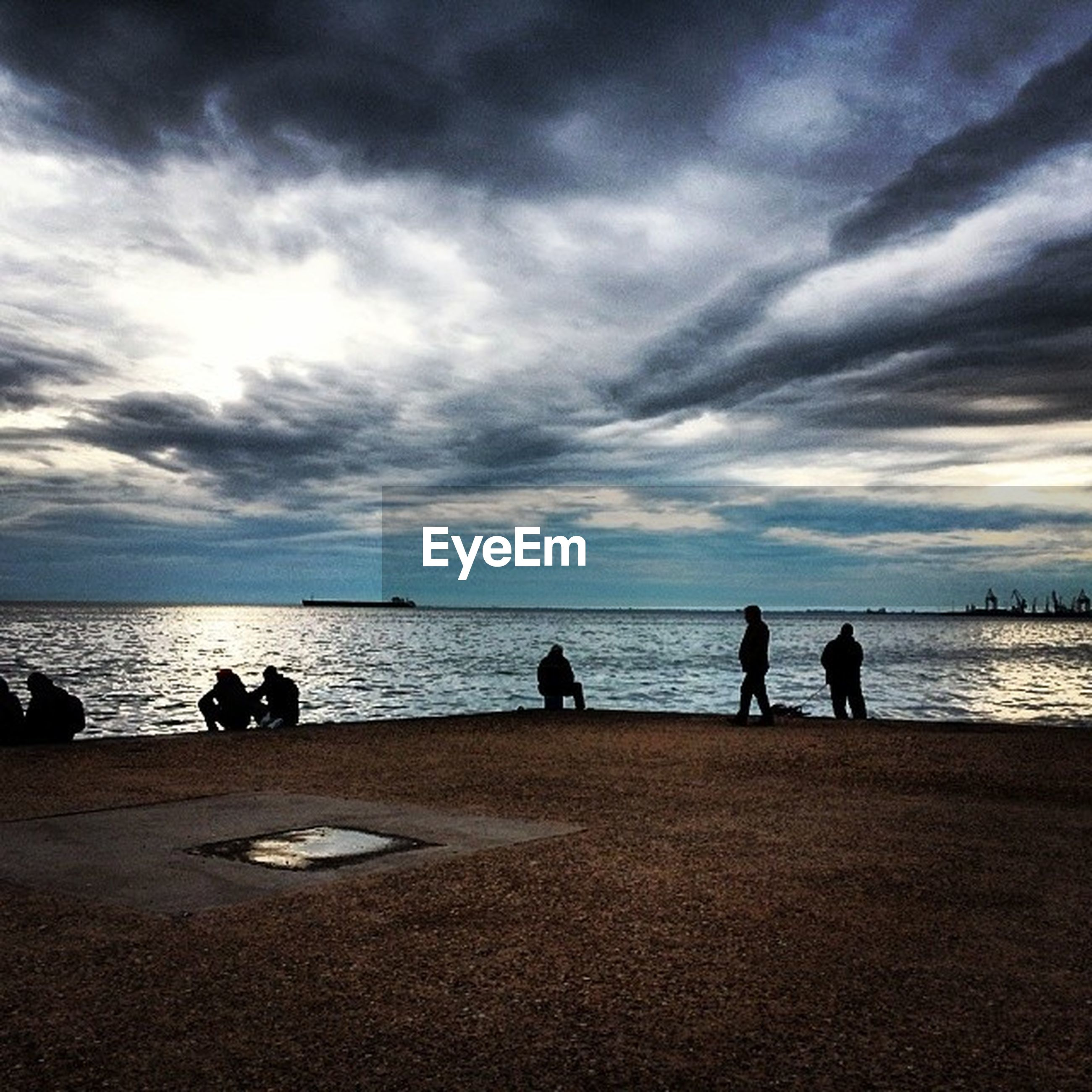 sky, water, sea, cloud - sky, beach, horizon over water, tranquil scene, scenics, tranquility, beauty in nature, cloudy, silhouette, shore, nature, cloud, leisure activity, men, idyllic, lifestyles
