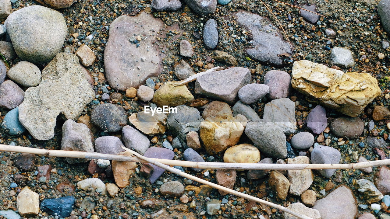 solid, rock, rock - object, stone - object, stone, high angle view, nature, pebble, day, no people, textured, land, large group of objects, outdoors, rough, beach, abundance, full frame, backgrounds, close-up, purity