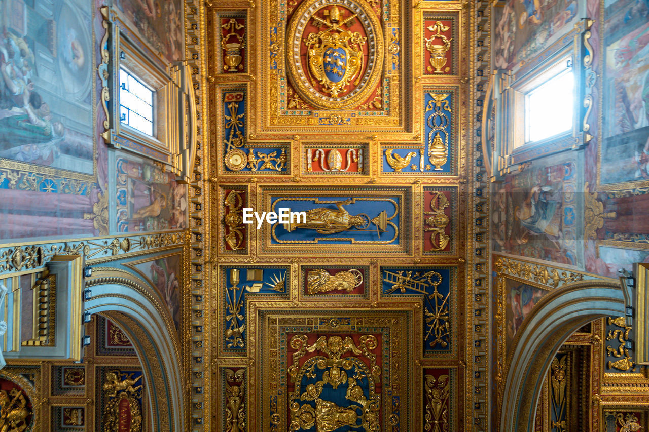 architecture, built structure, religion, belief, no people, place of worship, indoors, art and craft, travel destinations, ceiling, mural, building, spirituality, day, craft, design, low angle view, ornate, fresco, carving, architecture and art