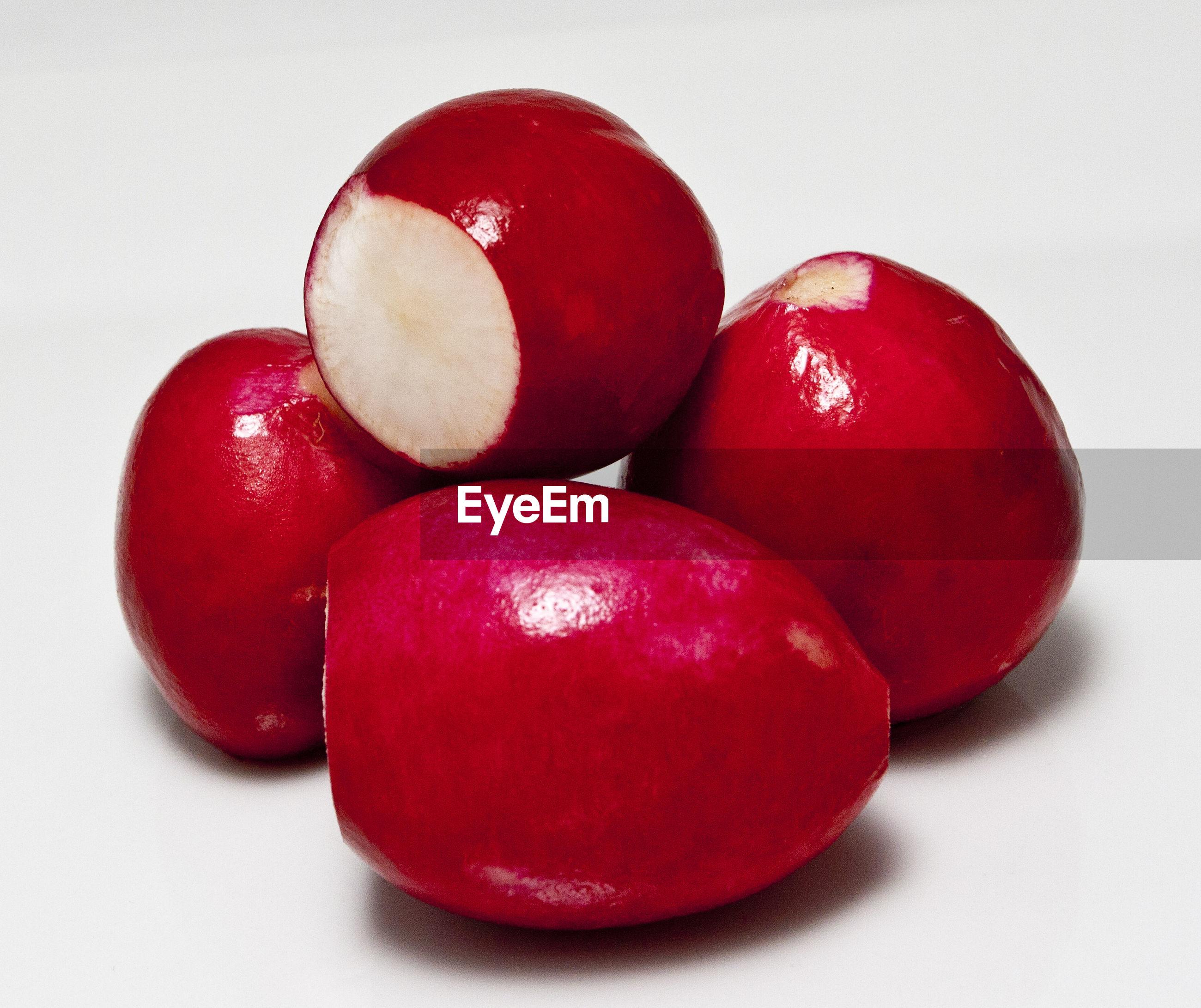 Close-up of radishes against white background