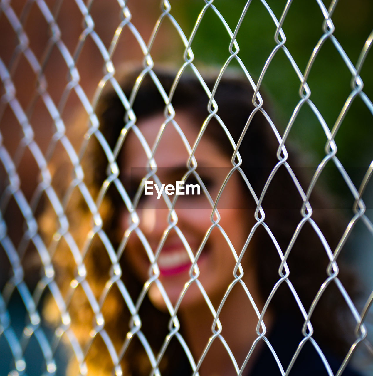 FULL FRAME SHOT OF CHAINLINK FENCE SEEN THROUGH WIRE