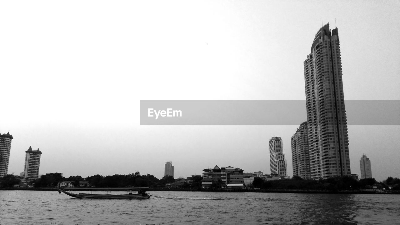 building exterior, built structure, architecture, water, sky, office building exterior, building, waterfront, city, skyscraper, tall - high, tower, nature, clear sky, no people, office, copy space, landscape, nautical vessel, modern, cityscape, outdoors, financial district