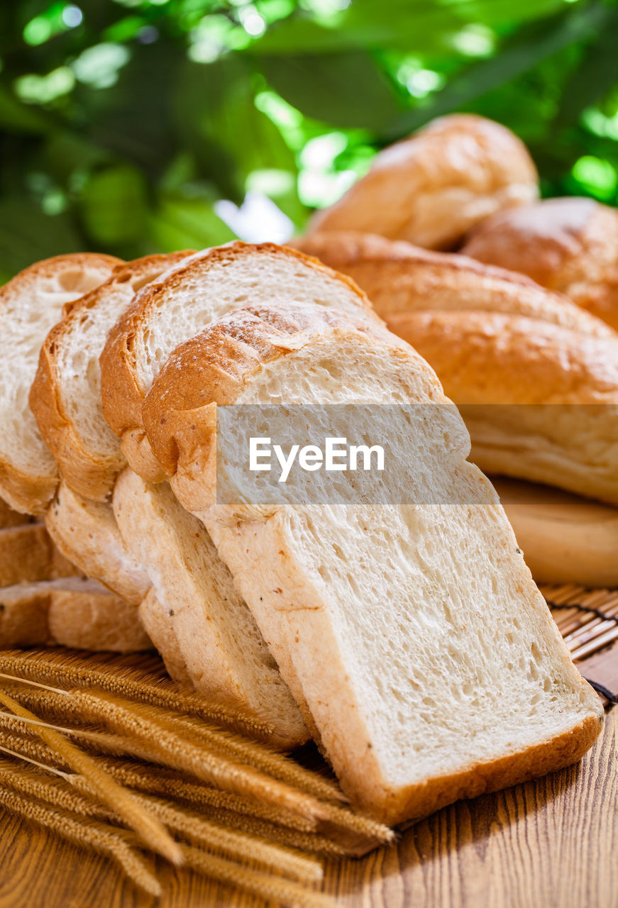 bread, food and drink, food, freshness, close-up, still life, focus on foreground, loaf of bread, wellbeing, no people, healthy eating, indoors, brown, baked, table, slice, basket, ready-to-eat, selective focus, large group of objects, brown bread, french food, breakfast, carbohydrate - food type