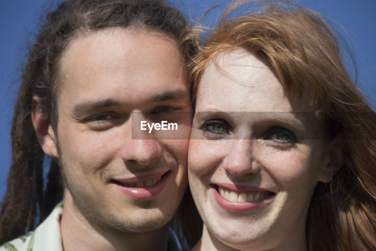 Close-up portrait of a happy couple