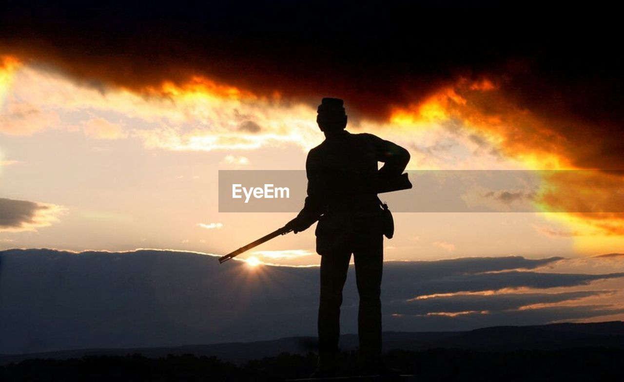 silhouette, sunset, standing, one man only, one person, outdoors, men, only men, adult, full length, adults only, nature, people, mountain, night, golf, sky, golf club, golfer