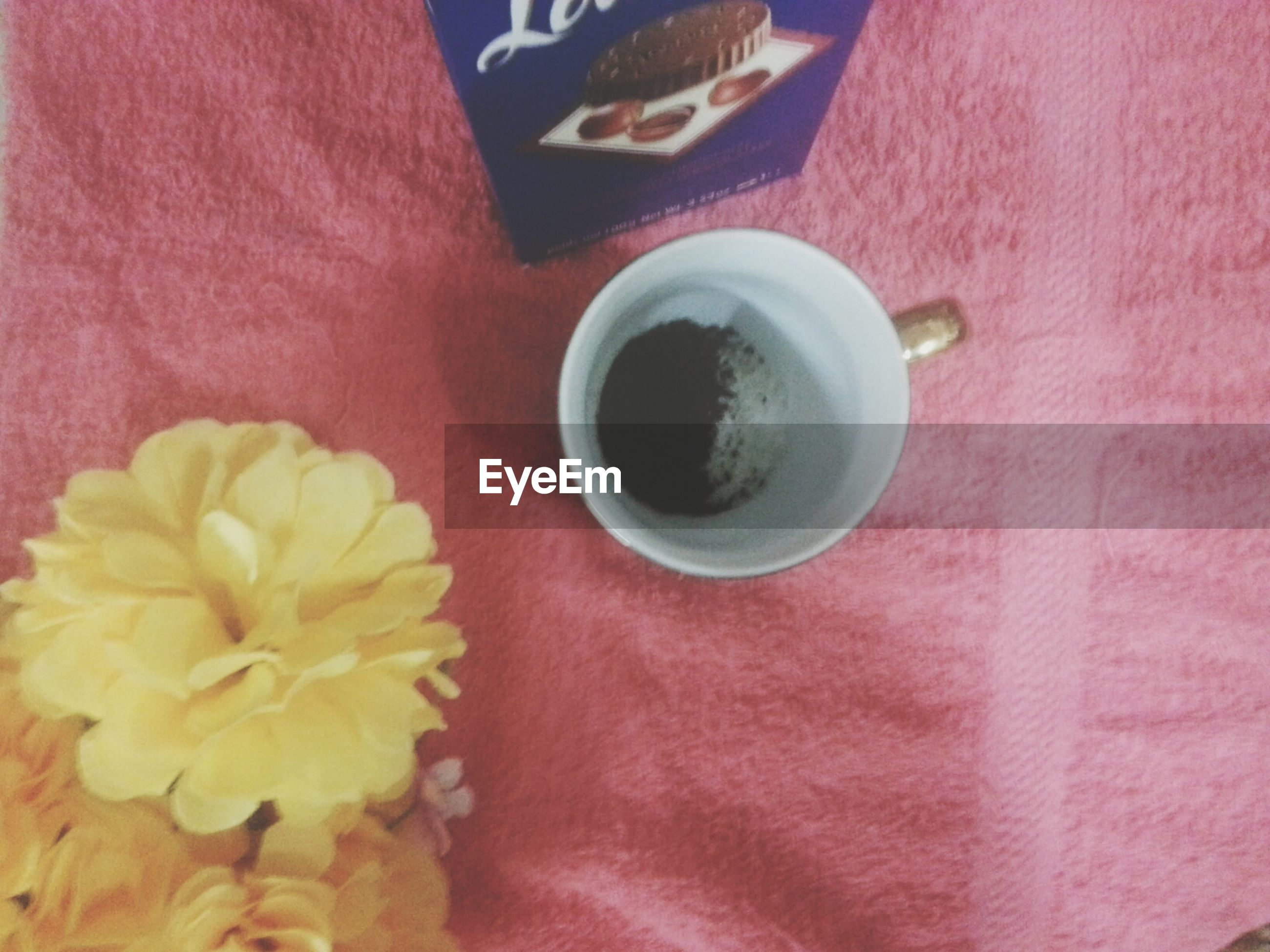 indoors, freshness, food and drink, coffee cup, drink, table, refreshment, still life, coffee - drink, high angle view, cup, coffee, saucer, spoon, directly above, flower, close-up, red, tea cup, no people