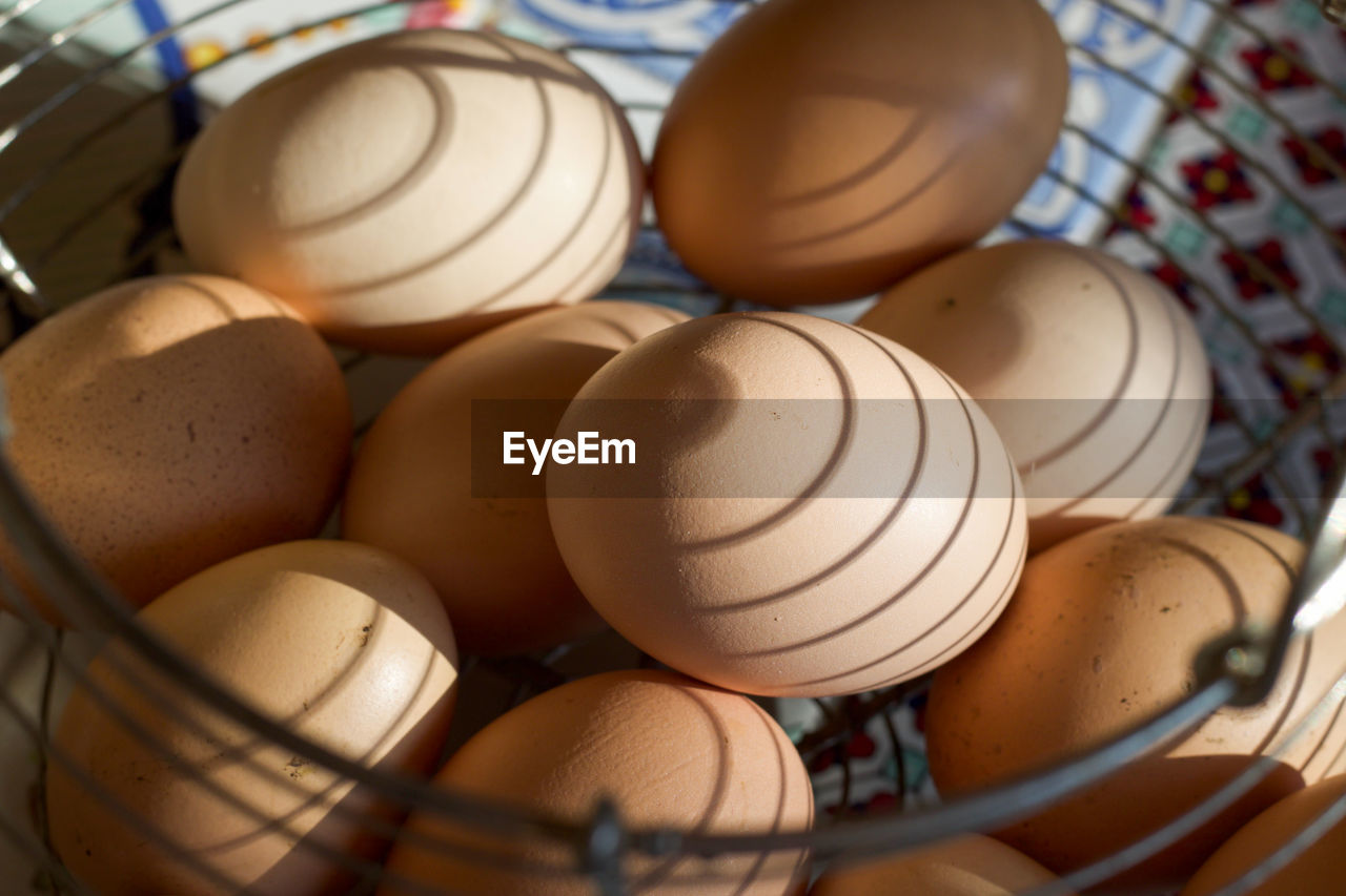 still life, egg, no people, close-up, food and drink, food, indoors, table, container, wellbeing, brown, healthy eating, high angle view, art and craft, kitchen utensil, bowl, selective focus, pattern, large group of objects, basket, crockery