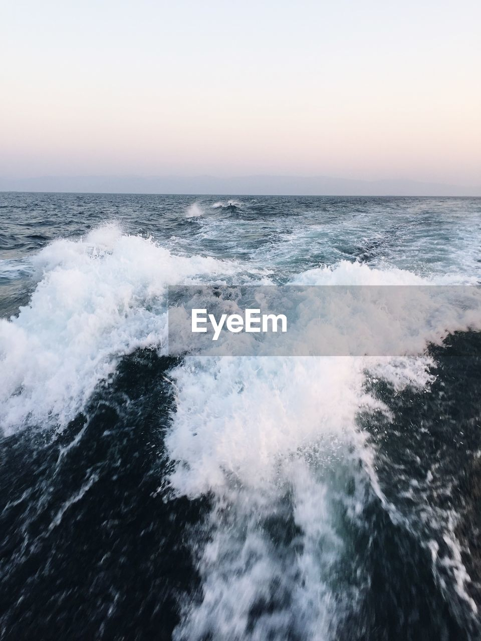 sea, water, beauty in nature, sky, scenics - nature, motion, horizon over water, horizon, wave, aquatic sport, sport, surfing, sunset, nature, waterfront, clear sky, power in nature, power, outdoors, breaking