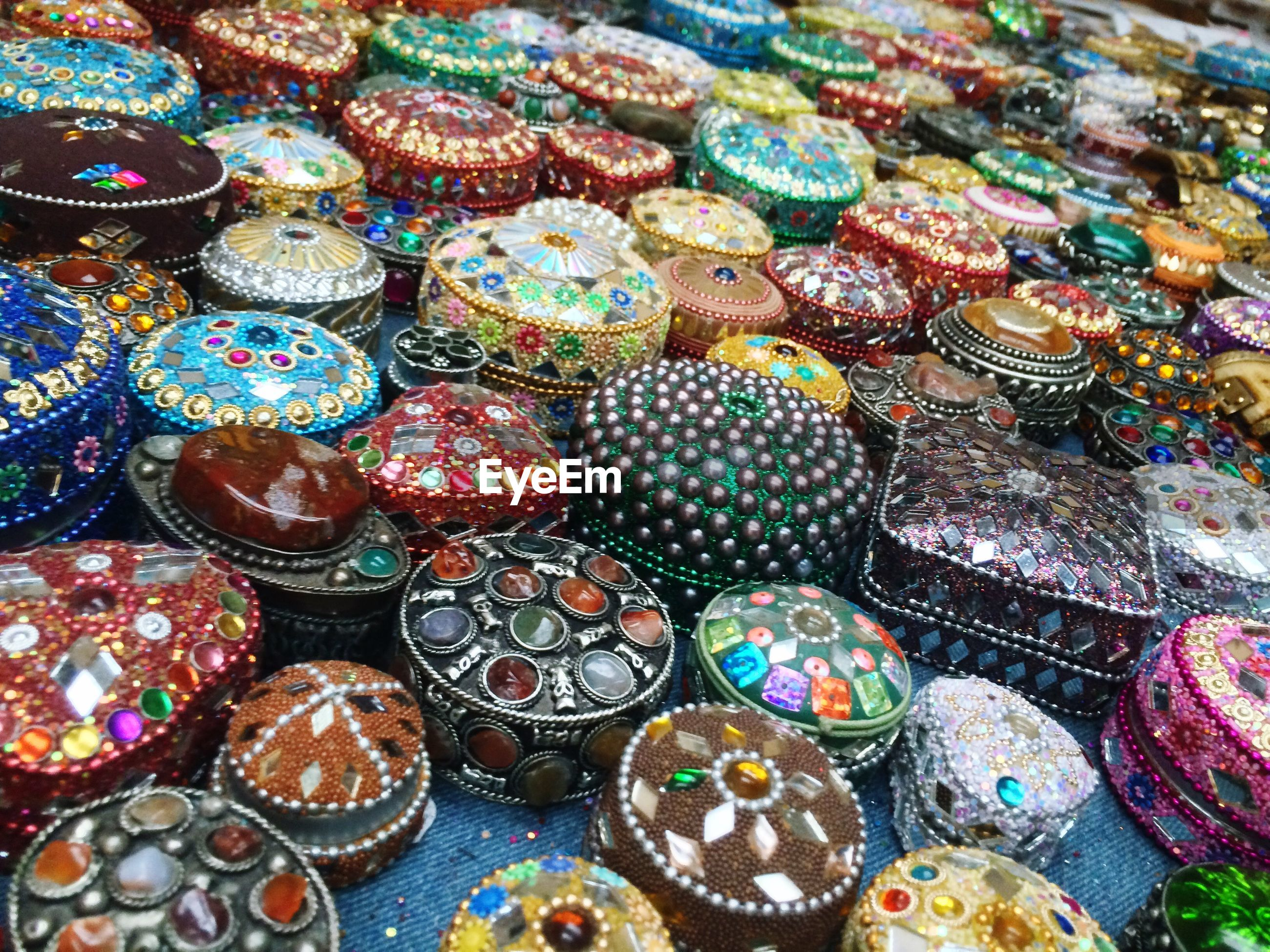 High angle view of various jewelry boxes