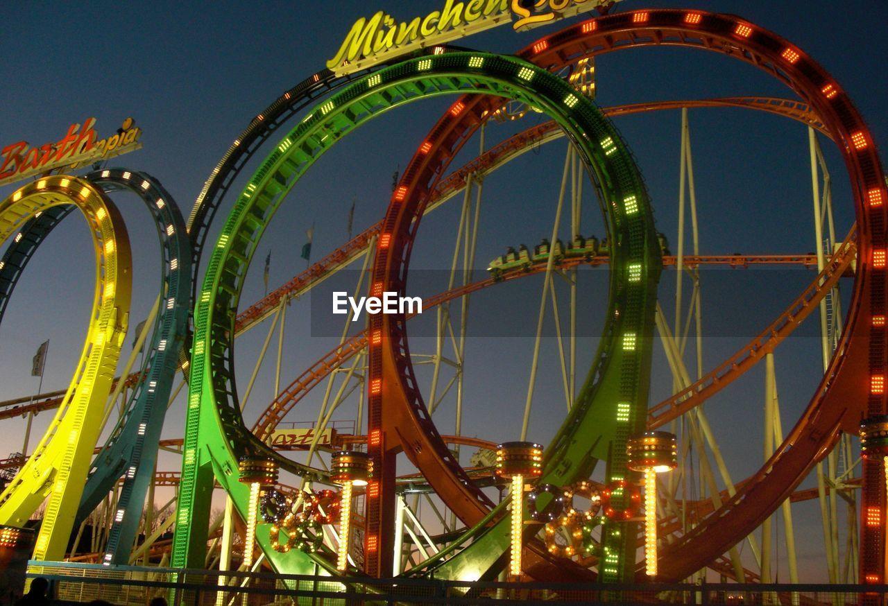 amusement park, arts culture and entertainment, night, outdoors, illuminated, no people, amusement park ride, architecture, city, sky