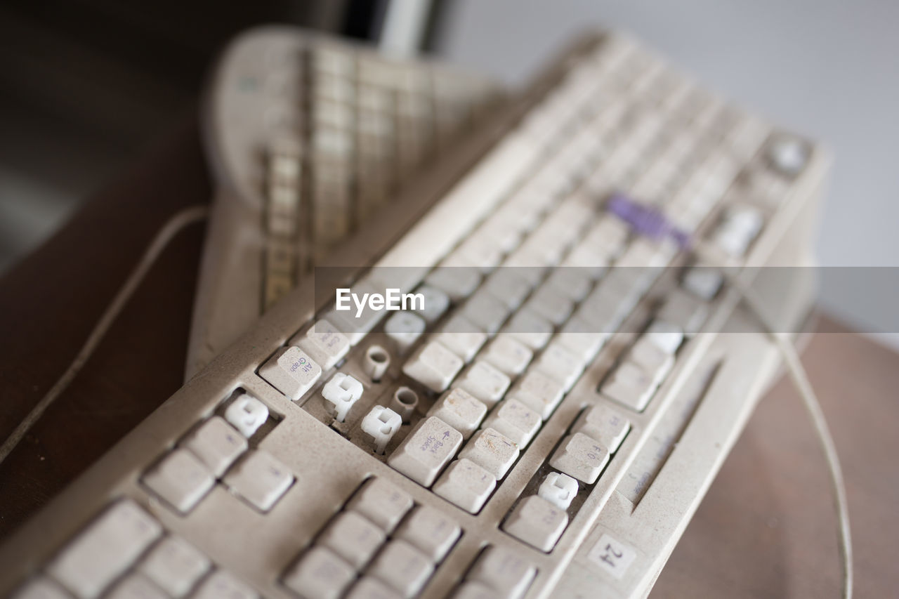 indoors, close-up, communication, technology, selective focus, focus on foreground, no people, text, number, connection, computer equipment, keyboard, still life, computer part, high angle view, western script, wireless technology, computer keyboard, table, computer, computer key