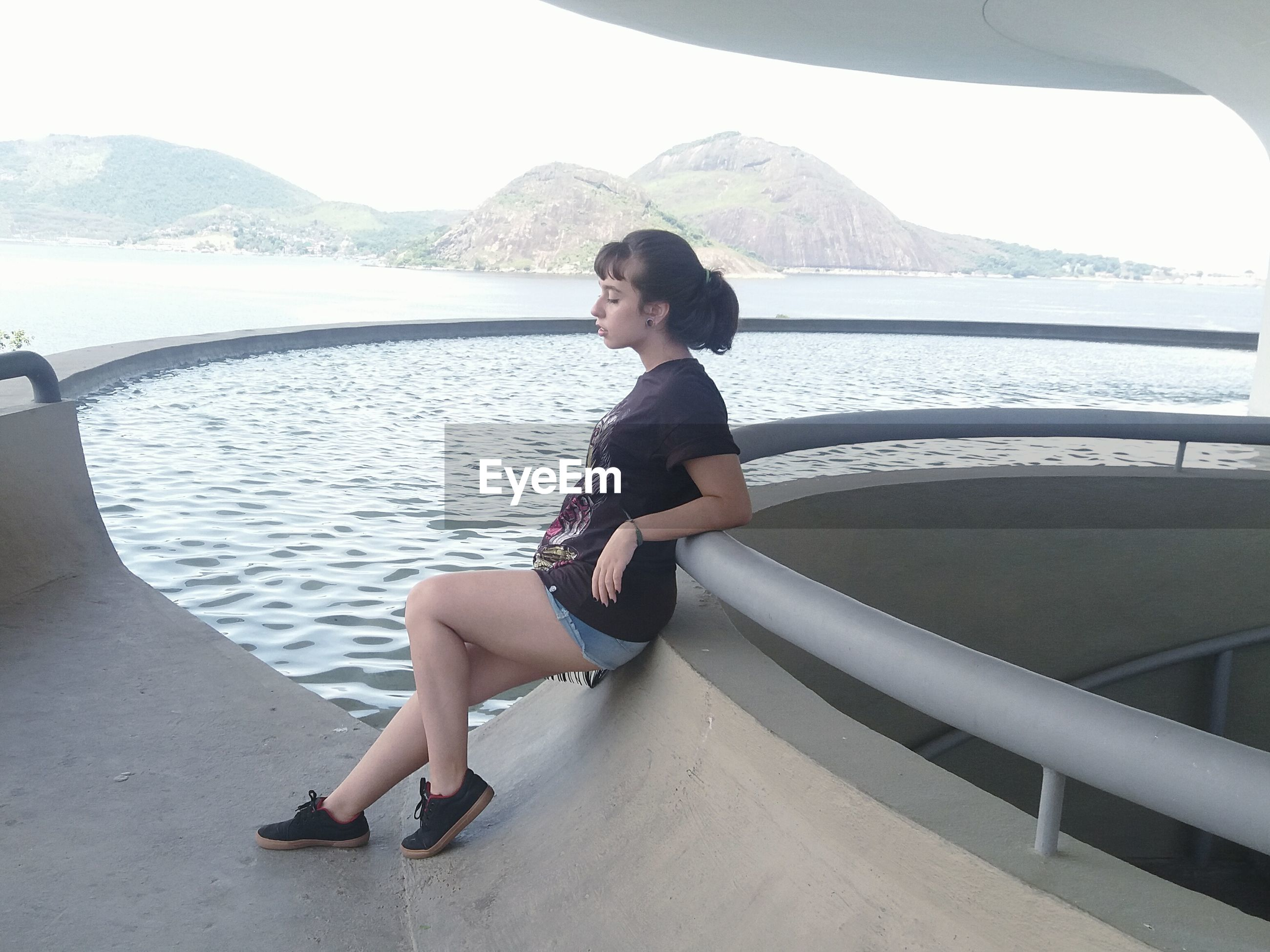 full length, sitting, side view, one person, lifestyles, day, water, sports clothing, people, young adult, adults only, adult, outdoors, sky, nature, one woman only, only women, one young woman only, beautiful woman, self improvement