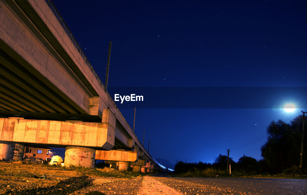 night, sky, architecture, built structure, nature, blue, space, star - space, illuminated, building exterior, bridge, no people, transportation, astronomy, moon, connection, bridge - man made structure, dusk, road, outdoors