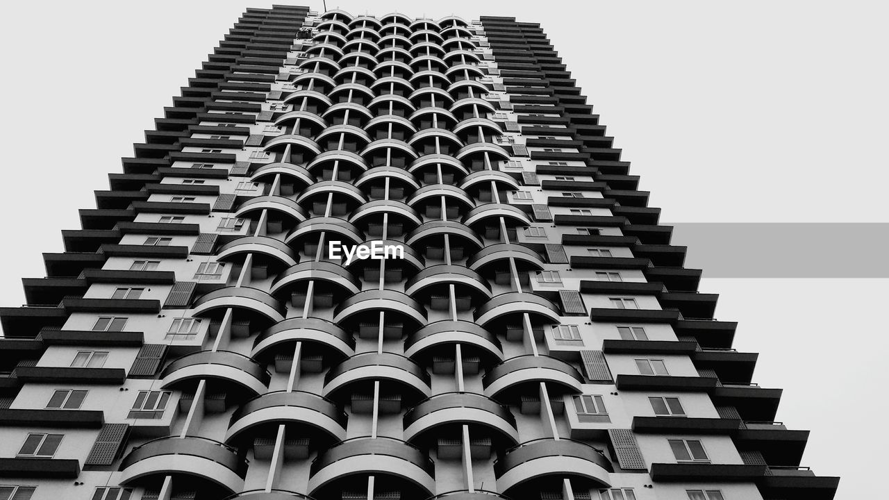 building exterior, architecture, low angle view, built structure, building, no people, sky, clear sky, city, repetition, tall - high, pattern, nature, office building exterior, modern, outdoors, day, architectural feature, tower, in a row, skyscraper, architecture and art