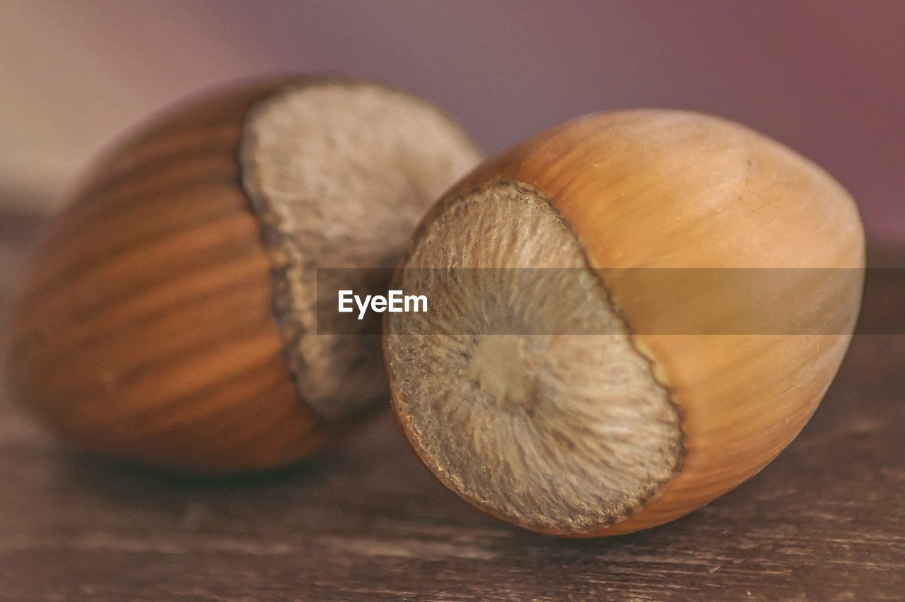 Close-up of chestnuts on wooden table