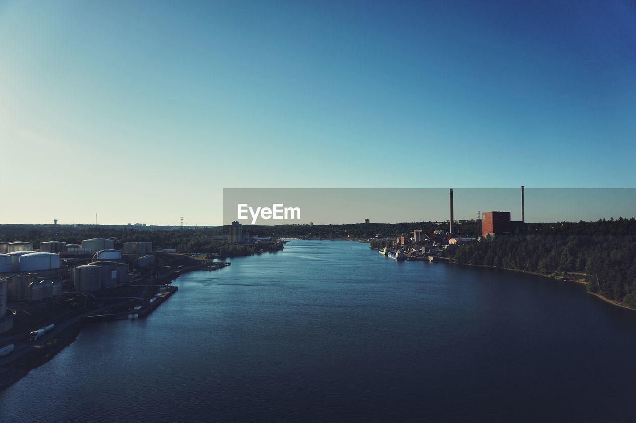 sky, architecture, built structure, copy space, water, clear sky, building exterior, nature, no people, building, waterfront, blue, direction, the way forward, city, transportation, day, river, outdoors, port