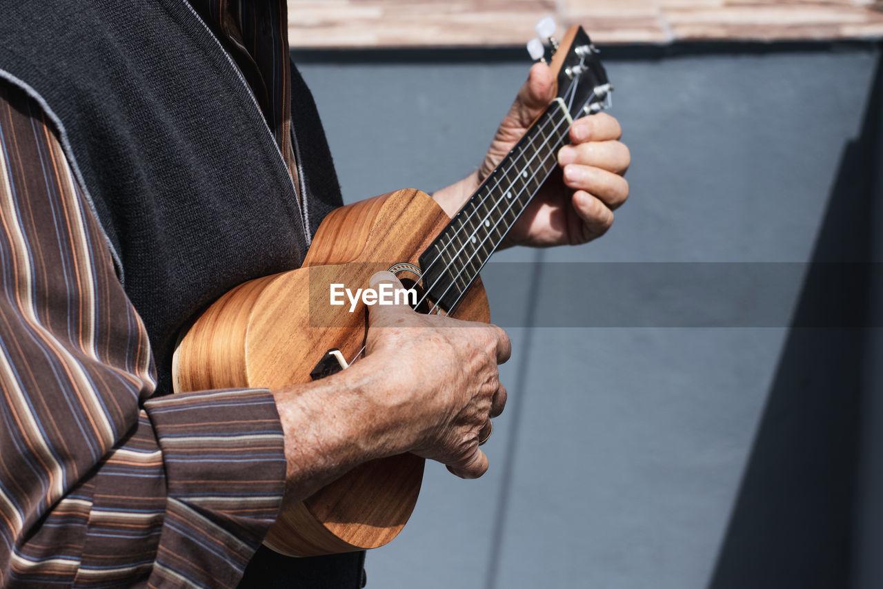 Grandpa playing a ukulele