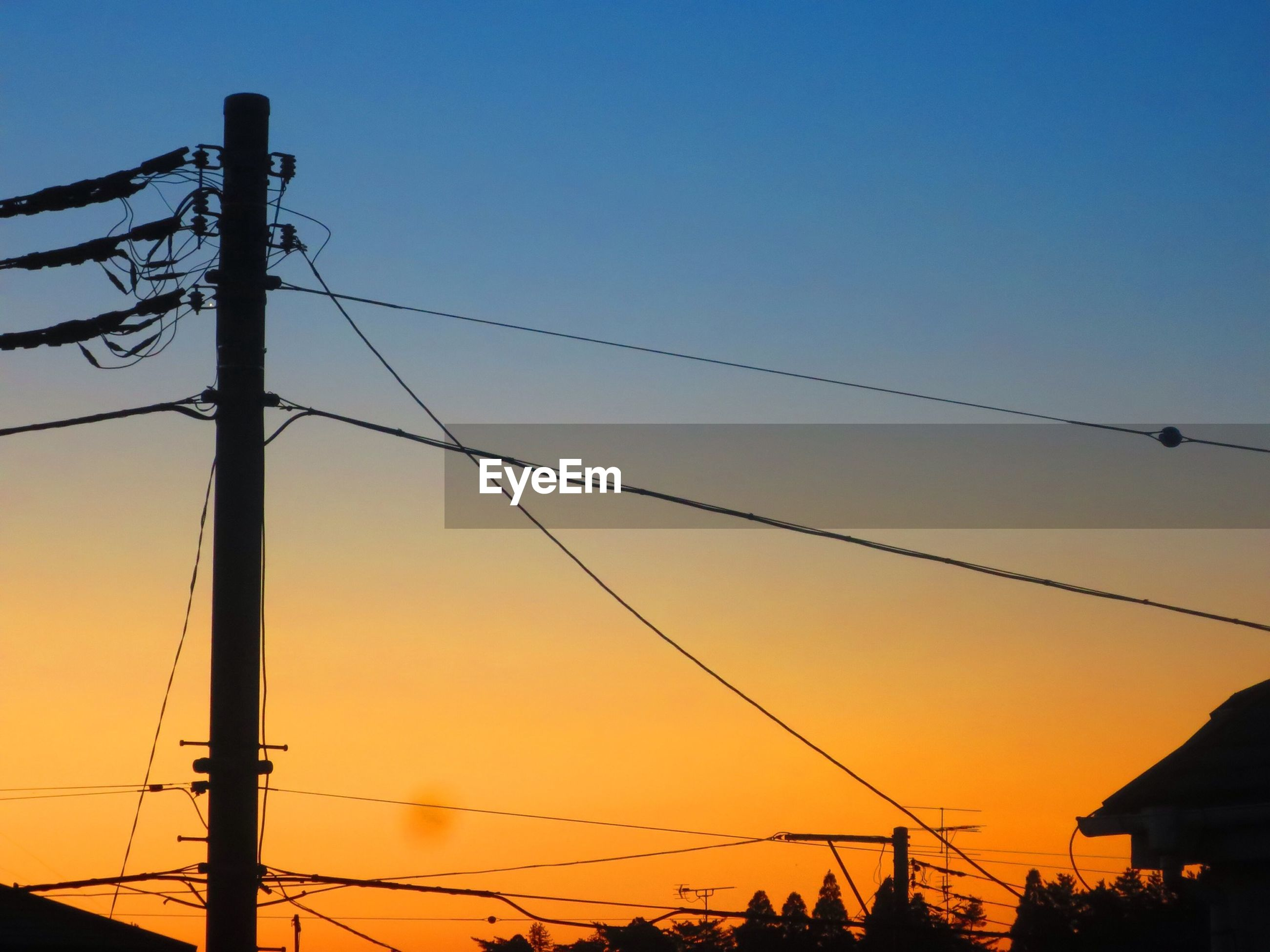 power line, sunset, low angle view, silhouette, electricity pylon, power supply, cable, electricity, connection, clear sky, technology, power cable, orange color, fuel and power generation, sky, dusk, blue, copy space, street light, wire