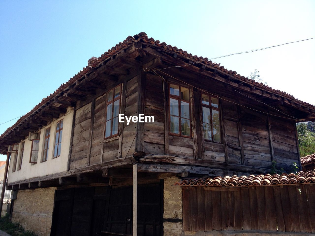 architecture, building exterior, abandoned, built structure, no people, window, clear sky, day, outdoors, wood - material, low angle view, roof, sky