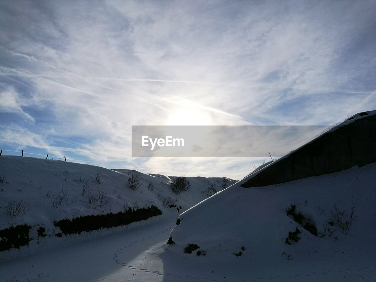snow, winter, cold temperature, nature, sky, beauty in nature, mountain, scenics, tranquility, sun, tranquil scene, sunlight, outdoors, landscape, cloud - sky, day, no people