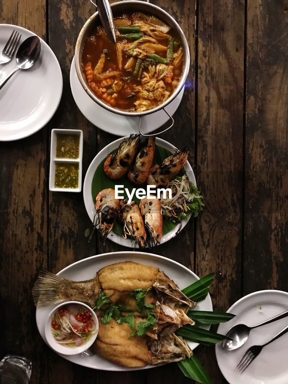 food and drink, food, table, freshness, ready-to-eat, healthy eating, still life, bowl, indoors, plate, wellbeing, high angle view, serving size, kitchen utensil, meat, no people, eating utensil, directly above, spoon, seafood, meal, temptation, garnish